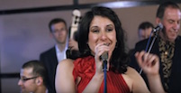 Dunia Correa, Cuban vocalist with Live Latin Band Cafecito, suitable for Wedding Reception Music, Dancing, Concerts, Parties & Corporate Event Entertainment